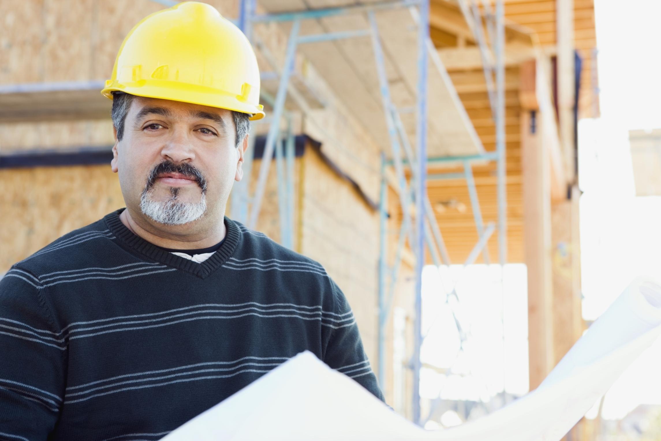 Man holding blueprints